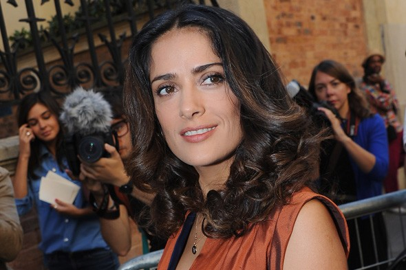 Salma Hayek arriving at the Balenciaga Spring/Summer 2012 show in Paris