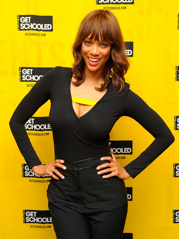 Hot or not: Tyra Banks shows off her moves at high school in a black jumpsuit
