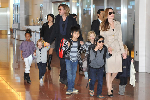Happy families: Brad and Angelina take their brood to Japan