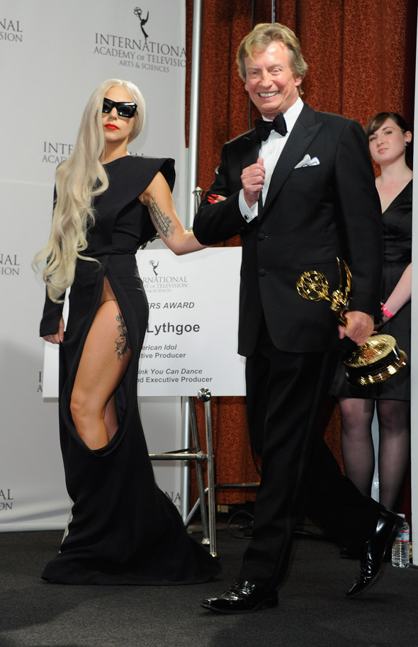 Lady Gaga just about avoids full frontal nudity with cutout dress