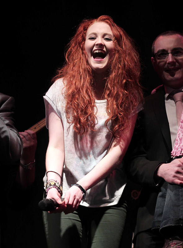 Janet Devlin embraces the power of the poncho to turn on Christmas lights