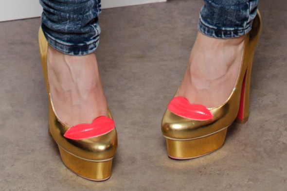 Golden girl: Nicola Roberts embraces festive shimmer with Barbie-esque shoes