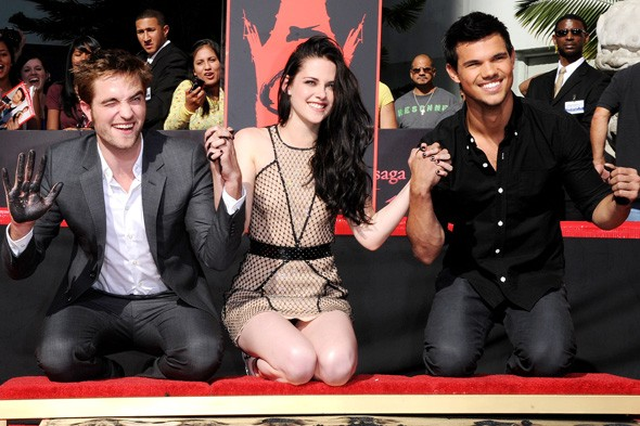 Robert Pattinson, Kristen Stewart and Taylor Lautner at their hand and footprint ceremony