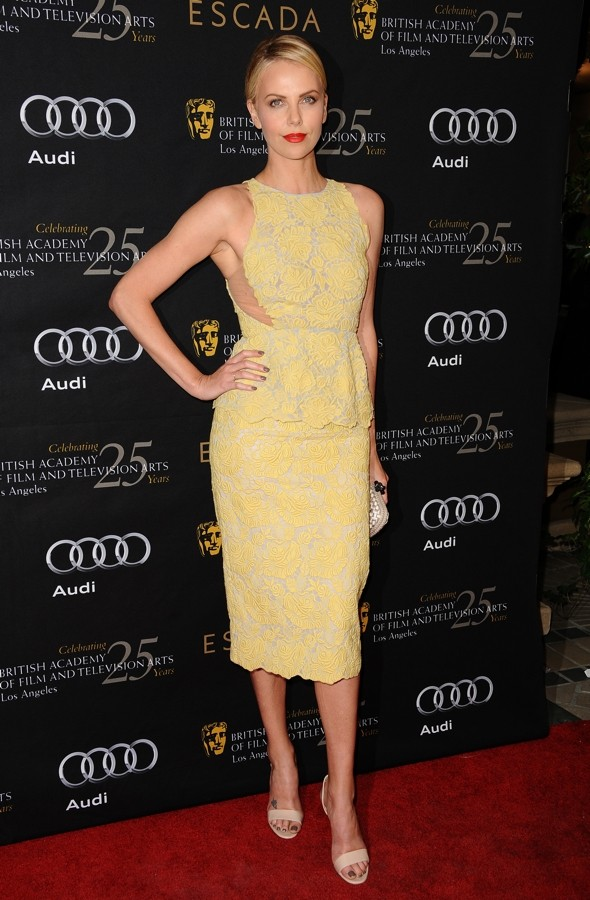 Charlize Theron is lovely in lemon lace