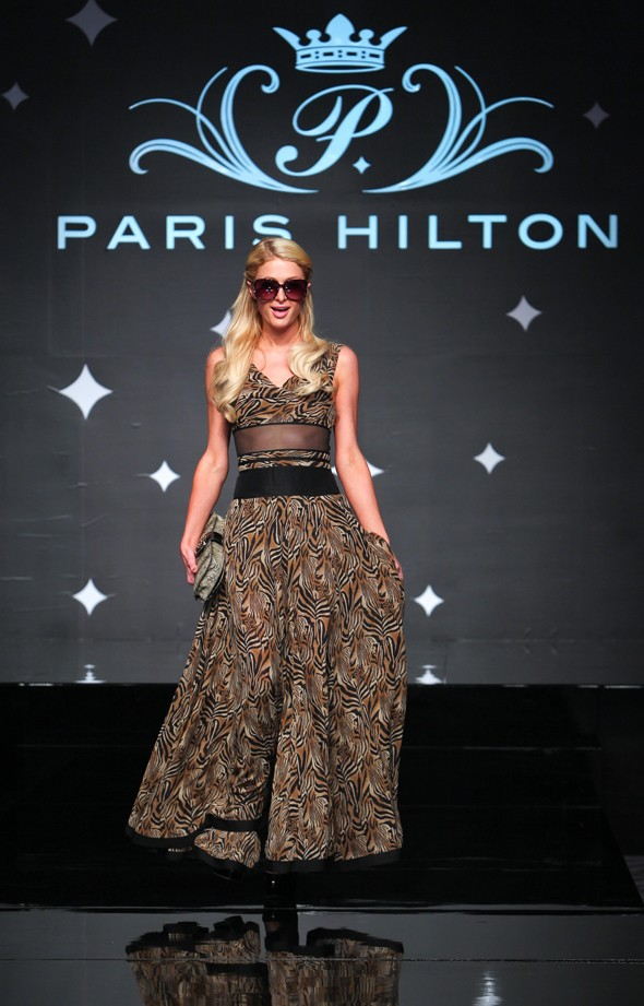 Specs appeal: Paris Hilton works a demure dress at sunglasses press conference