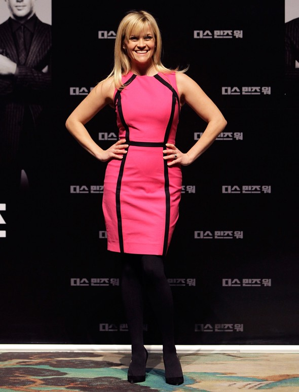 Reece Witherspoon pops in neon pink at This Means War press conference