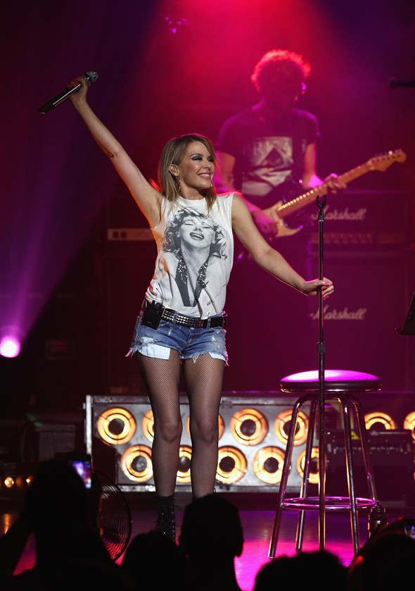 Still got it: Kylie hits the stage in Melbourne in tiny denim shorts
