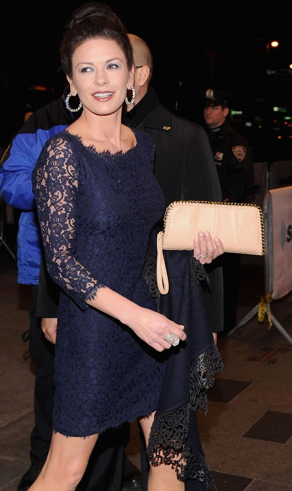 Catherine Zeta Jones embraces lace trend, shows off wonder pins