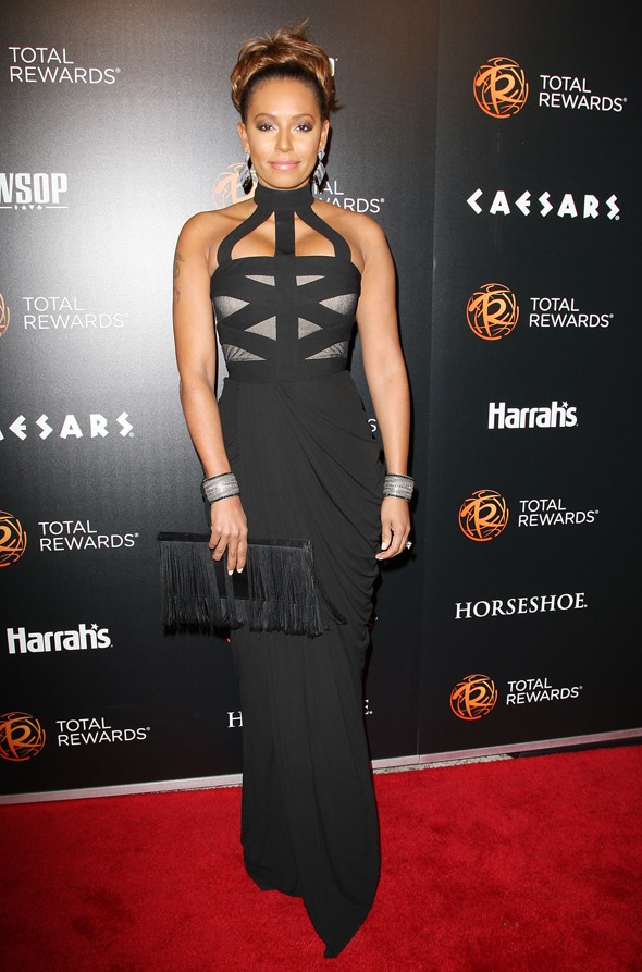 Strapping lass: Mel B attends concert in bondage-inspired dress