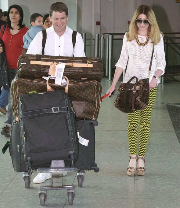 Nicola Roberts and Charlie Fennell arrive at Heathrow airport