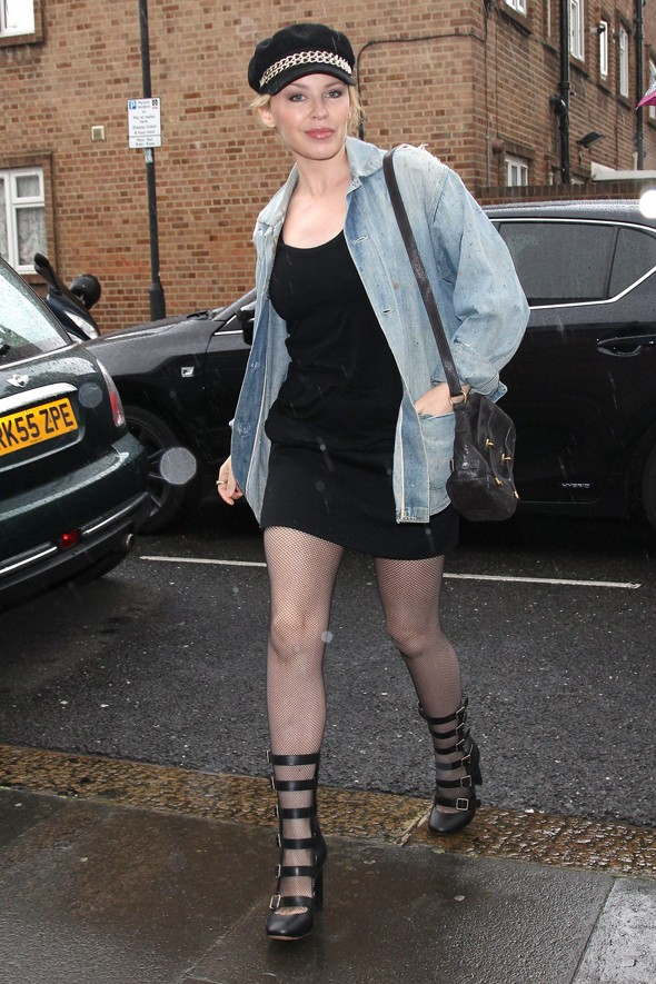 Masterpiece or disasterpiece: Kylie dons denim, straps and a baker boy hat