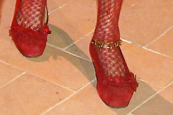 The Duchess of Alba dons red fishnets to pick up Telva award in Spain
