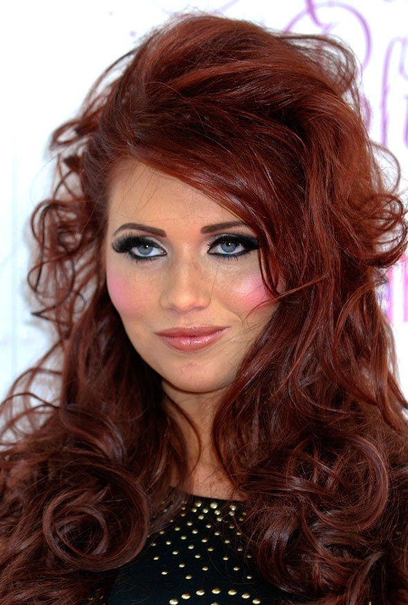 Amy Childs overdoes the hairspray (naturally) to kick off Essex Fashion Week