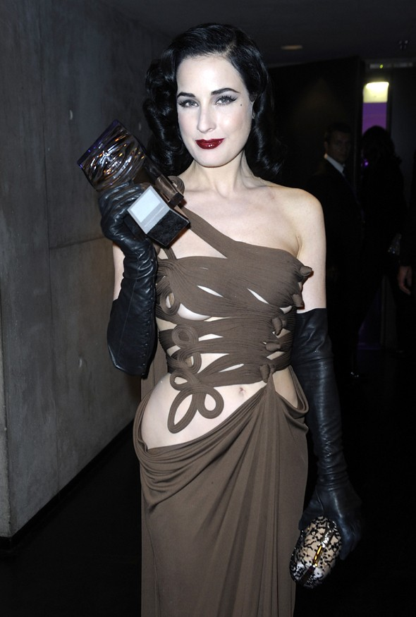 The big reveal: Dita Von Teese wears sexy cut-out dress at Duftstars Awards