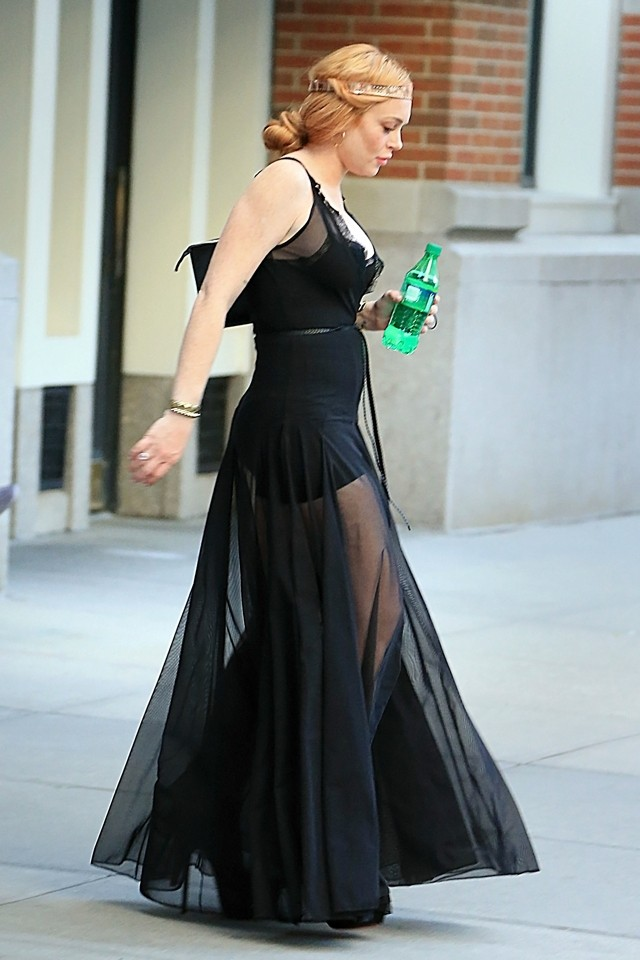 Lindsay Lohan Shows Off Fuller Figure In See-Through Dress At New York Fashion Week