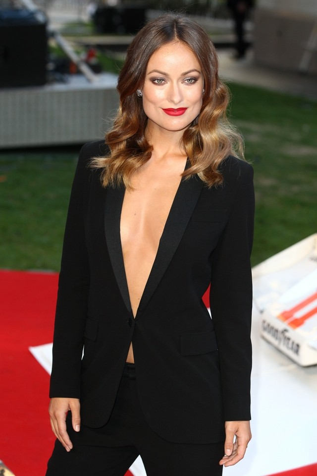 Wilde Thing: Olivia Takes The Plunge In Braless Tuxedo At London Premiere of Rush