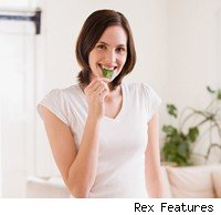 Woman eating spinach