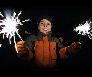 Child on Bonfire Night with sparklers