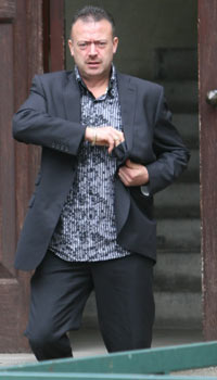 Clayton Summerell, owner, leaving court, dog attack