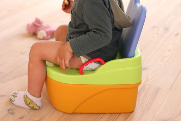How can I get my reluctant son toilet trained?