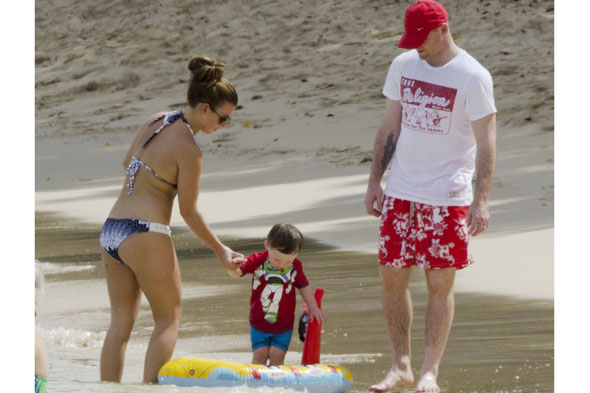 Mum Coleen Rooney shows off her bikini body on the beach with son Kai