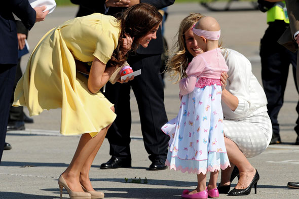 Maternal Kate Middleton embraces six-year-old cancer tot