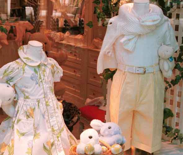 Cutesy baby gear and children's outfits  in a shop window