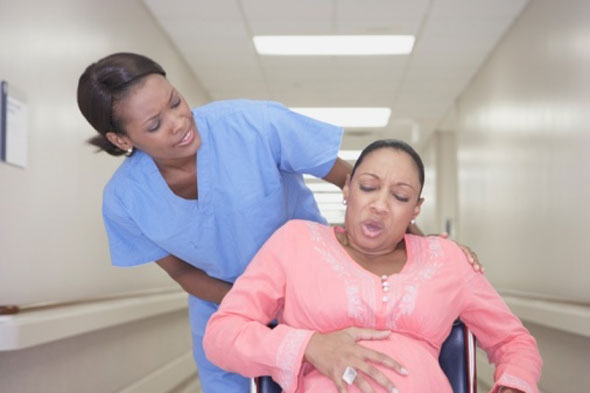 Woman in labour with midwife