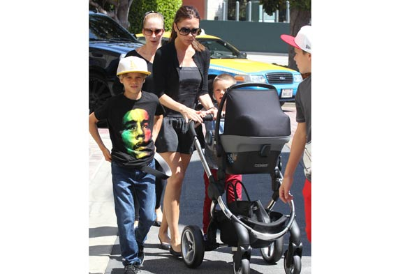 Victoria Beckham shows off baby Harper in FLAT SHOES
