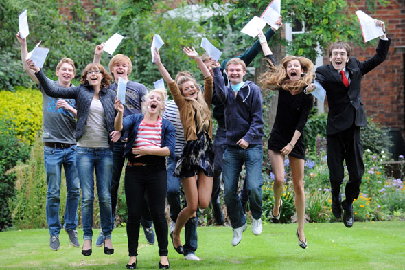 Students celebrating A-level results before university