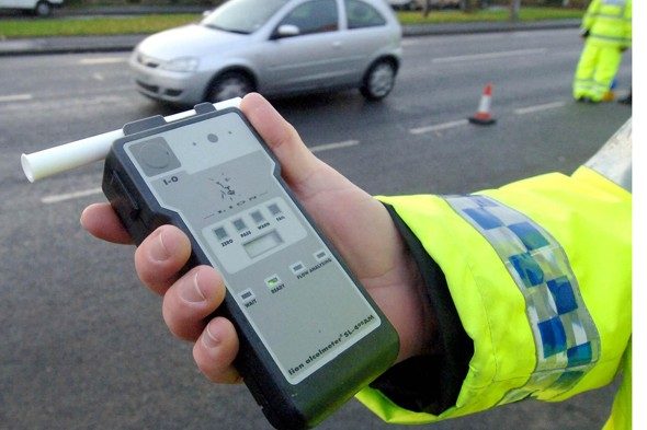 Police breathalyser used on drink driving mother