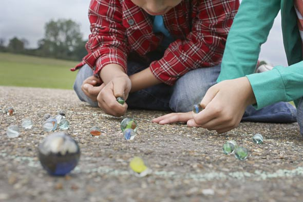 Children as young as five getting into debt playing marbles in the street!