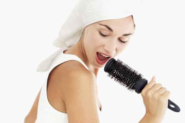 Singing into a hairbrush microphone