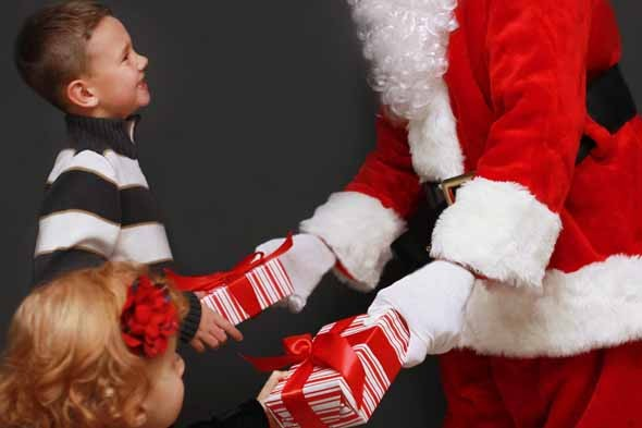 Father Christmas, Santa Claus, giving presents to children