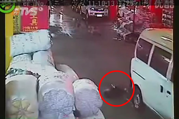 Horrific footage of toddler girl run over TWICE in China