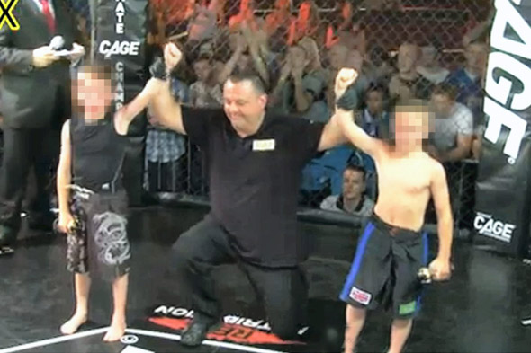 Eight year old boys cage fighting