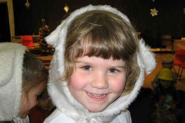 Child dressed as a sheep in nativity play