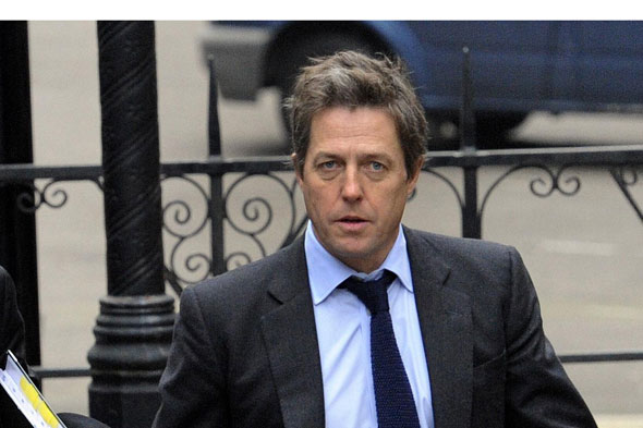 Hugh Grant arrives at the Leveson inquiry at the High Court