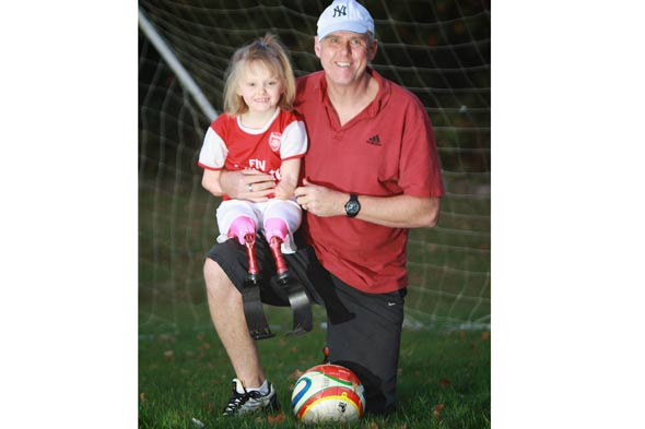 Girl of the match: Brave Ellie plays football without arms and legs