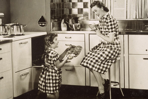 Nostalgic 50s picture of mother and child cooking