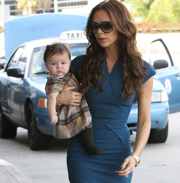 Harper Seven Beckham is the spitting image of mum Posh Spice - except for the brown tights