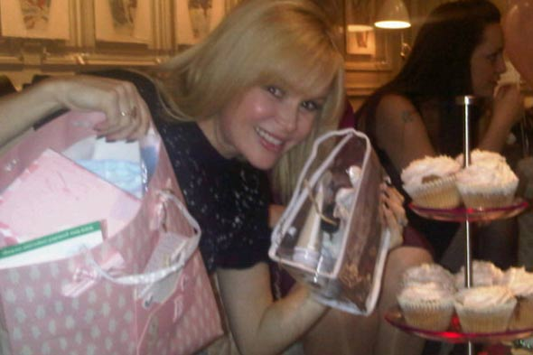 Pregnant Amanda Holden's over the balloon as friends throw baby shower