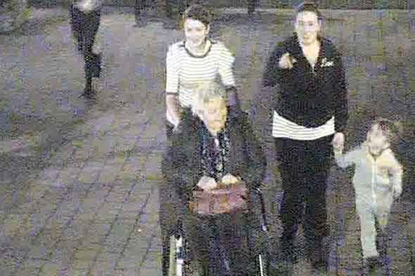 Woman holds little boy's hand as she's caught on CCTV stealing a garden GNOME