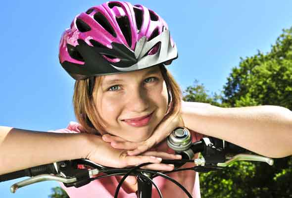 Girl bike riding: teens and exercise
