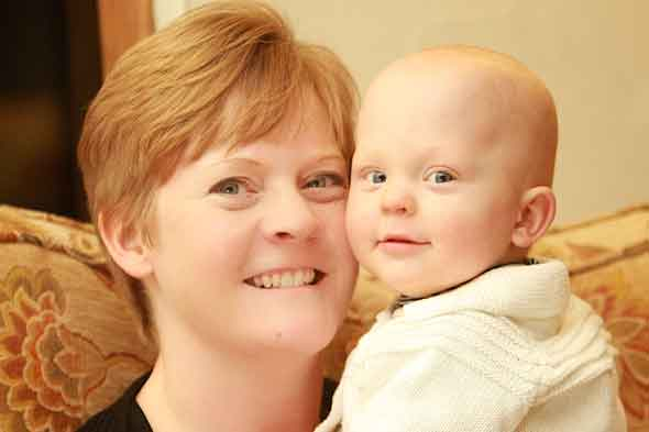 The baby whose mum has to tickle his feet every night to keep him alive
