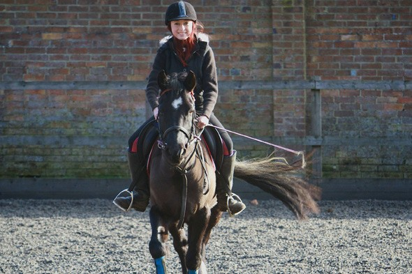 Laura Fitzwalter can now ride her horse again after her back operation to straighten her spine