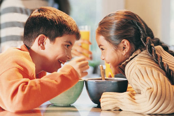 Children eating and enjoying food