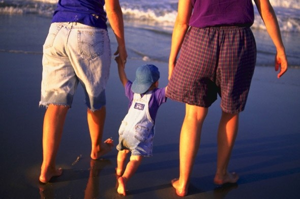 Couple on the beach with child