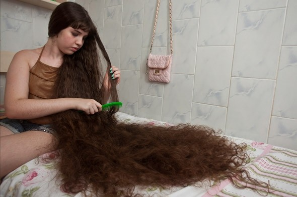 At 5ft 3in (1.6m) long, 12 year-old Natasha's hair is almost almost LONGER than her.