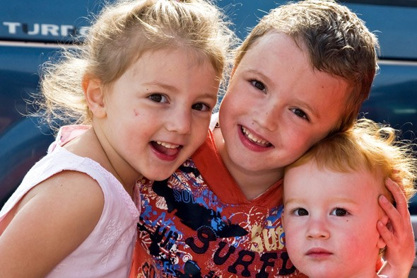 Dominic Stacey with his younger sisters
